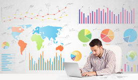 Business man with colorful charts. Graphs Royalty Free Stock Photo