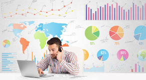 Business man with colorful charts. Graphs Royalty Free Stock Photography