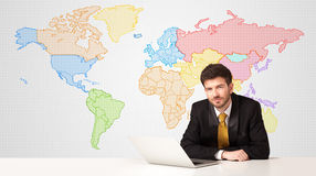 Business man with colorful world map background Royalty Free Stock Photo