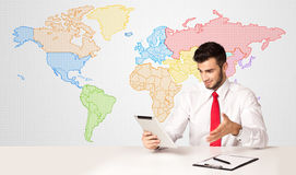 Business man with colorful world map background Royalty Free Stock Photography