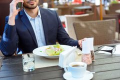 Business man communicating on phone in cafe Stock Image