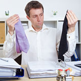 Business man comparing two ties. Business man comparing two different ties in his office Stock Photography