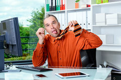 Business man is completely over-worked Royalty Free Stock Image