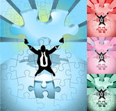 Business man completing jigsaw Stock Photos