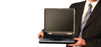 Business man with computer. Business man holding a laptop with a blank screen royalty free stock photo