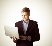 Business man with computer Royalty Free Stock Photos