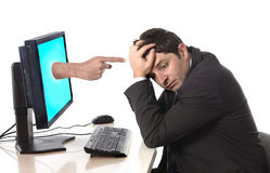 Business man with computer in stress concept. Business man with computer and hand with accusing finger pointing at him in stress and crisis concept Stock Photos