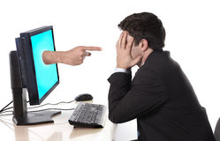 Business man with computer in stress concept. Business man with computer and hand with accusing finger pointing at him in stress and crisis concept Stock Photography