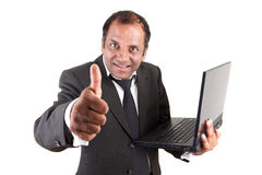 Business man with computer and thumb up Royalty Free Stock Photo