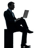 Business man computing laptop computer silhouette Stock Photo