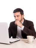 Business man concentrating on a laptop Stock Images