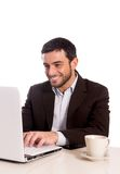 Business man concentrating on a laptop Royalty Free Stock Photo