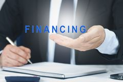 Concept of financing. Business man with the concept of financing stock photos