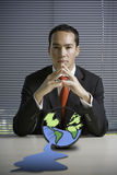 Business man concerned with earth Stock Photography