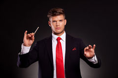 Business man conducting orchestra stock images