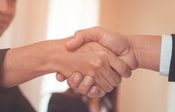 Business man with confidence handshake with partner. Happy business man with confidence handshake with partner royalty free stock images