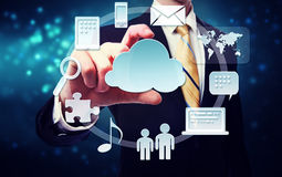 Business man with connectivity through cloud computing concept. Business man with cloud computing connection concept on blue technology background Royalty Free Stock Photography