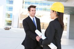 Business Man and Construction Woman Stock Photo
