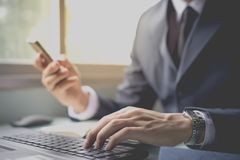 Business man contact customer online. By social network and mobile phone Stock Photography