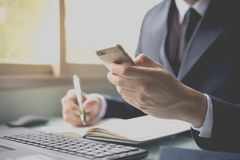 Business man contact customer online. By social network and mobile phone Stock Images