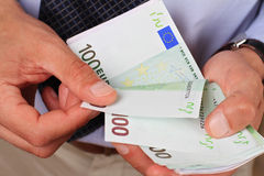 Business Man counting money. Success, investment, financial growth, profit, dividends concept Stock Image