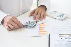 Business man counting money at the table accounting concept.  stock images