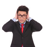 Business man covering ears Royalty Free Stock Images