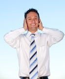 Business man covering his ears Royalty Free Stock Photography
