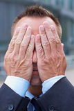 Business man covering his face Royalty Free Stock Photos