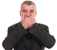 Business man covers his mouth Royalty Free Stock Photography