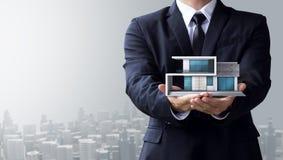 Business man create design modern house Stock Image