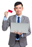 Business man with credit card and computer Royalty Free Stock Images