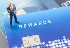Business man on the credit card,online shoping concept. Miniature business man on the credit card,online shoping concept Royalty Free Stock Photography