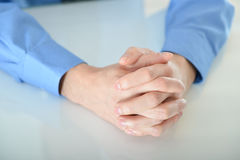 Business man with crossed hands. Resting on table Royalty Free Stock Photo