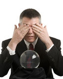 Business Man With Crystal Ball. Looks for guidance stock image