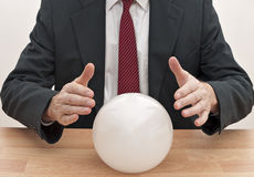 Business man with crystal ball - concept Stock Images