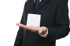 Business man with cube in hand Stock Photo