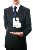 Business man with cube in hand Stock Photography
