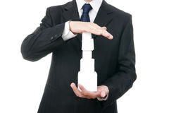 Business man with cube in hand Stock Images