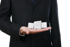 Business man with cube in hand Stock Photos
