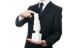 Business man with cube in hands Royalty Free Stock Photos
