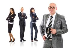 Business man with cup of tea with a group Royalty Free Stock Photography