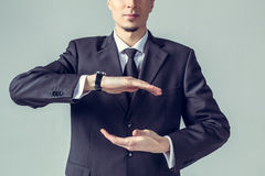 Business man with cupped hands Royalty Free Stock Photos