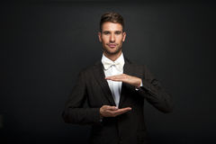 Business man with cupped hands as if holding something. Stock Photo
