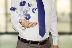 Business man with currency symbols. Business man with floating currency symbols Royalty Free Stock Photography
