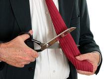 Business man cutting own tie - white background Stock Image
