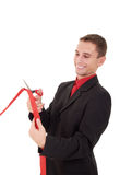 Business man cutting a red ribbon. With scissors royalty free stock images