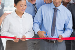 Business man cutting red strip Royalty Free Stock Photography