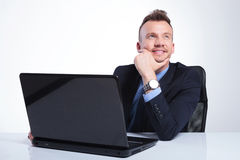 Business man daydreaming at his laptop Stock Images