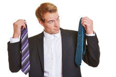 Business man deciding for tie Royalty Free Stock Image